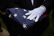 The Knights of Columbus – 4th Degree hold an American flag before the Presentation of the Colors and Flag Raising during the Veterans Day Ceremony at Milpitas City Hall's Veterans Plaza in Milpitas, California, on November 11, 2013. (Stan Olszewski/SOSKIphoto)