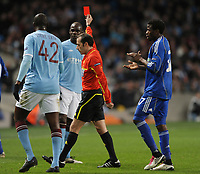 Mario Balotelli looks stunned after being given the Red Card from Referee Cuneyt Cakir<br />Manchester City 2010/11<br />Manchester City v Dynamo Kiev 17/03/11<br />UEFA Europa League Last 16 2nd Leg<br />Photo: Robin Parker Fotosports International