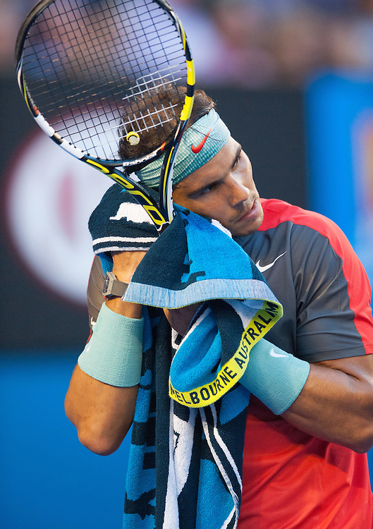 Stanislaus Wawrinka of Switzerland defeated the number one player in the world R. Nadal of Spain (shown here) to claim the 2014 Australian Open Men's Singles Championship. The Swiss won 6-3 6-2 3-6 6-3 in a match that will be remembered for a confusing and sometimes bizarre final three sets, with Nadal clearly hampered by a left lower back injury and seemingly on the verge of retirement in the second set.. The match was held on center court at Melbourne's Rod Laver Arena.