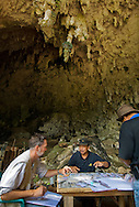 """Team leader Thomas Sutikna and stone tool expert Mark Moore discuss the Liang Bua .dig, discovery site of the Flores """"hobbit"""", Homo floresiensis"""