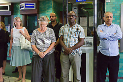 © Licensed to London News Pictures. 07/07/2015. London, UK. People observe a minute silence at Aldgate tube station in London, on the tenth anniversary, for victims of the 7/7 bombings. Photo credit : Vickie Flores/LNP