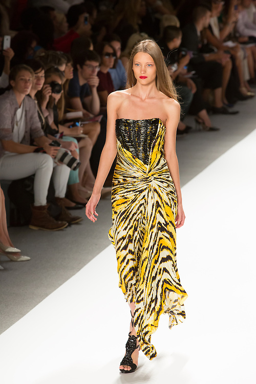 An animal print strapless gown in Yellow, cream and black with baded bodice. By Carlos Miele at the Spring 2013 Mercedes-Benz Fashion Week in New York.