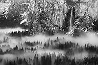 Bridalveil Falls and Yosemite Valley floor in fog, Yosemite National Park, California USA