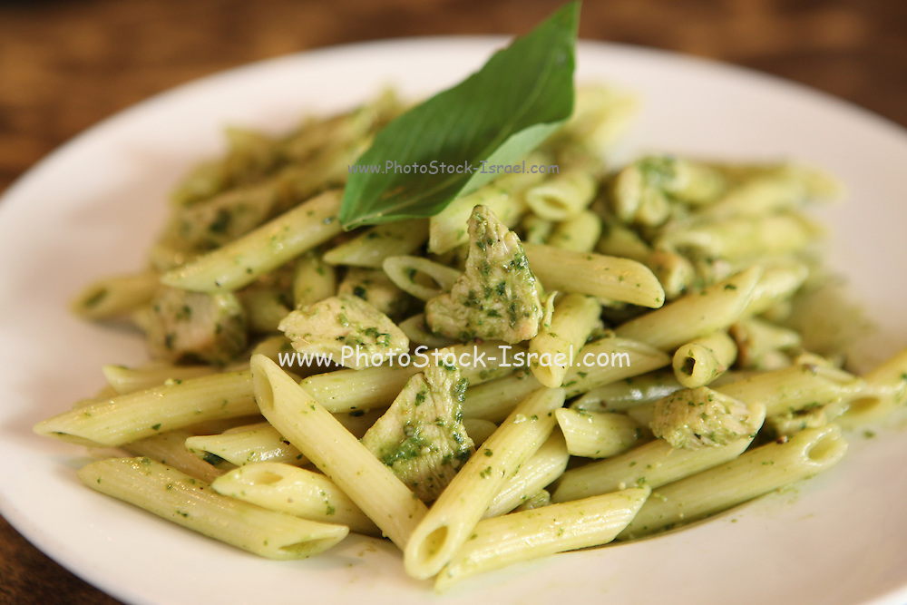 A serving of Penne pasta with herbs and cheese