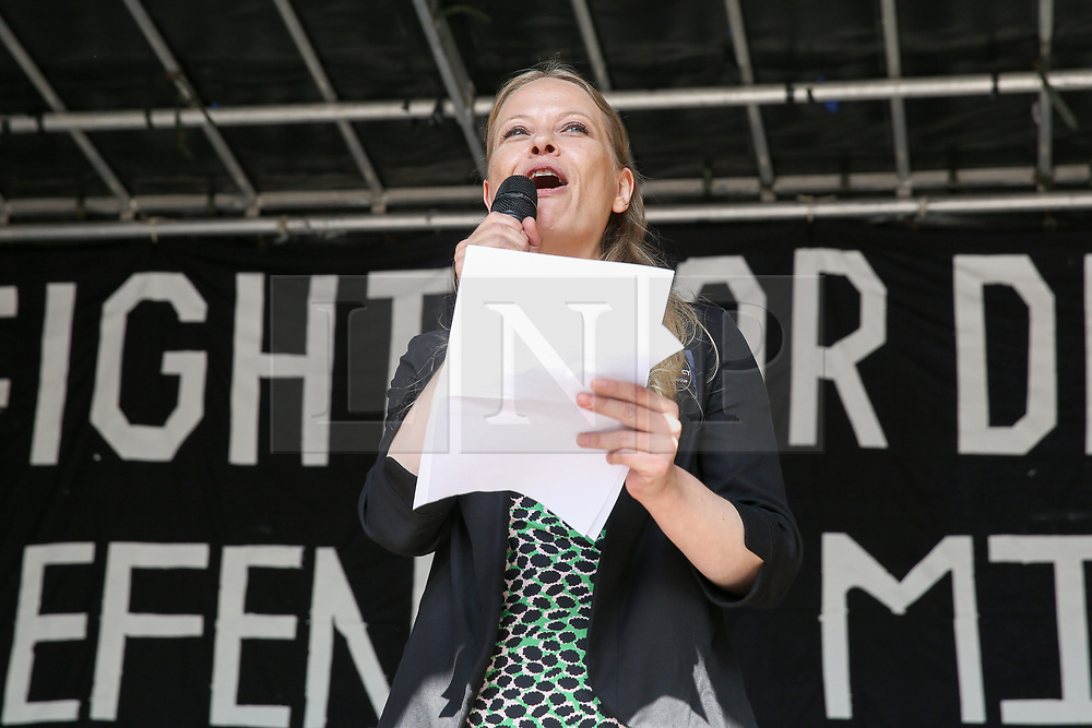 © Licensed to London News Pictures. 31/08/2019. London, UK. Siân Berry, Co-Leader of the Green Party addressees the rally in Whitehall as tens of thousands of protesters demonstrates outside Downing Street in London against British Prime Minister Boris Johnson's plans to suspend parliament for five weeks ahead of a Queens Speech on 14 October, just two weeks before the UK is set to leave the EU. Photo credit: Dinendra Haria/LNP