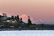 Mount Baker (Washington State) behind the city of White Rock.  Photographed from West Beach in White Rock, British Columbia, Canada.