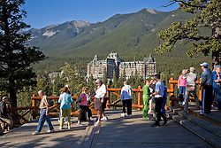 Tourists overlooking Banff Springs Hotel in Banff National Park