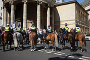 Mounted police between protesters of the Free Tommy Robinson demonstration, and their opposition organised by anti-fascist groups including Stand up to Racism who are opposed to far right politics on 24th August 2019 in London, United Kingdom. Some 250 Stand Up To Racism and other anti-fascist groups took to the streets today in opposition to supporters of jailed 'Tommy Robinson' real name Stephen Yaxley-Lennon at Oxford Circus, who gathered outside the BBC.
