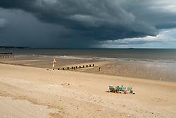 Families enjoying the sun and sand of Bridlington Holiday resort on North Beach West Yorkshire as a rain storm threatens<br />  4 August 2016<br />  Copyright Paul David Drabble<br />  www.pauldaviddrabble.photoshelter.com