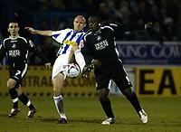 Photo: Chris Ratcliffe.<br /> Colchester United v Swansea City. LDV Vans Trophy. 14/03/2006.<br /> Wayne Brown (L) of Colchester tackles Adebayo Akinfenwa of Swansea