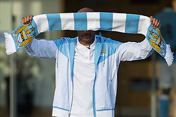 © Licensed to London News Pictures . 17/07/2015 . Manchester , UK . FABIAN DELPH poses with a Manchester City scarf outside the Etihad Stadium after signing for Manchester City Football Club , from Aston Villa . Photo credit : Joel Goodman/LNP