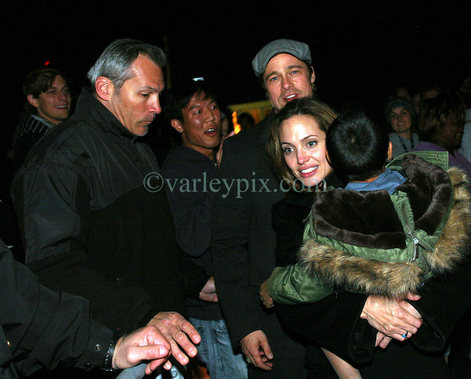 Dec 03 2007. New Orleans, Louisiana. Lower 9th Ward.<br /> Brad Pitt revisits the Lower 9th ward, devastated by Hurricane Katrina to present 'Make it Right' where architects' designs are unveiled to the public. Brad with Angelia Jolie and Maddox mingling with the crowd listening to the evening concert.<br /> Photo credit; Charlie Varley/varleypix.com