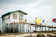 Philippines, Tawi Tawi. Traditional house on Simunul Island built on stilts in the water. Simunul Island is a place where islam was introduced to the Philippines.