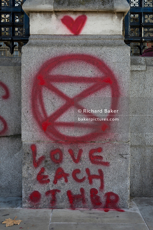 Graffiti left by members of Extinction Rebellion sprayed on the perimeter wall of the the UK Government's Palaces of Westminster, on 14th November 2018, in London, England.