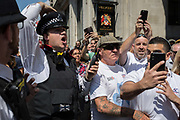 Members of the far-right make a counter-demonstration to those against the visit of US President Donald Trump to the UK, march through central London, on 13th July 2018, in London, England.