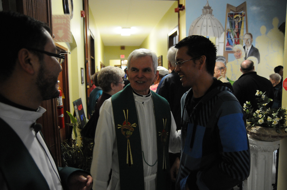 Father John Canary (center) and St. Eulalia Pastor Carmelo Mendez (L) chat with Gabriel Lara in the newly-inaugurated Quinn Community Center in Maywood. The project to reopen the church's former parish school into a vibrant neighborhood building has been an initiative of Mendez, naming the center for former St. Eulalia Pastor William Quinn. Quinn made a lasting history for himself as a pioneer for social justice, both in the fields of civil rights, along with those of immigrants in the U.S. He died in 2004.