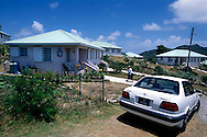 Nurse Cooper (with hat) checks up on the old and vunerable in the new northern community of Lookout. Thousands were evacuated from their homes in the south of the island after it was abandoned after the 1995 and 1997 eruption of the Soufriere Hills volcano. The southern area which contained most of the farm land is still out of bounds to everyone except scientists..