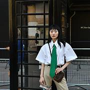 Sinyu Siu (@sinyusiu) attend London Fashion Week SS19 street photography at the Strand, London, UK. 17 September 2018.