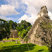 Temple 1, also known as the Temple of the Great Jaguar or Temple of Ah Cacao in the Tikal Maya ruins in northern Guatemala, now enclosed in the Tikal National Park. At the left of frame is the Main Plaza.