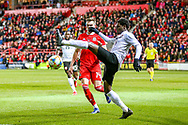 Trinidad and Tobago defender Alvin Jones clashes with Wales midfielder Ryan Hedges during the Friendly European Championship warm up match between Wales and Trinidad and Tobago at the Racecourse Ground, Wrexham, United Kingdom on 20 March 2019.