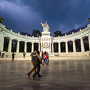 People visiting Benito Juárez Hemicycle in Alameda Central Park, Mexico City