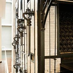 Dans le batiment Afrique, les anciens equipement sont restes pour la decoration du lieu. Visite des Grands Moulins de Pantin ou la BNP-Paribas vient d'installer ses services d'echanges de titres. Pantin, France. 24 fevrier 2010. Photo : Antoine Doyen