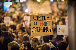 6 December 2019, Madrid, Spain: 'Winter is Not coming' reads a sign, as thousands upon thousands of people march through the streets of central Madrid as part of a public contribution to the United Nations climate meeting COP25, urging decision-makers to take action for climate justice.