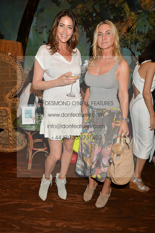Left to right, LISA SNOWDON and MEG MATHEWS at a tea party to launch Grace Guru held at Sketch, 9 Conduit Street, London on 17th June 2015.