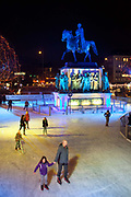 People ice skating at the Weihnachtsmarkt Kölner Altstadt / Heimat der Heinzel / Home of the Gnomes / Elves market, Cologne, Germany.