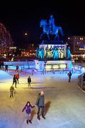 People ice skating at the Weihnachtsmarkt Kölner Altstadt / Heimat der Heinzel / Home of the Gnomes / Elves market, Cologne, Germany.