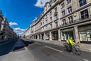 Regent Street is very quiet, but not empty - A sunny day and people are out in reasonable numbers, throughout London, to get their daily exercise.  The 'lockdown' continues for the Coronavirus (Covid 19) outbreak in London.