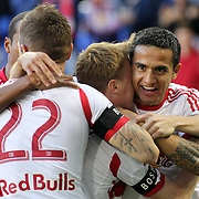Tim Cahill, (right), New York Red Bulls, celebrates a goal by Dax McCarty, along with team mate Jonny Steele and Roy Miller, (left), during the New York Red Bulls V New England Revolution, Major League Soccer regular season match at Red Bull Arena, Harrison, New Jersey. USA. 20th April 2013. Photo Tim Clayton