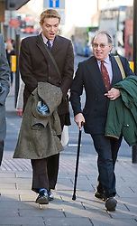© Licensed to London News Pictures. 13/01/2012. Oxford, UK.  James Murray (left), the son of the Earl of Mansfield arriving at Oxford Crown Court today (13/01/2012) with his brother Viscount Stormont (right). James Murray is accused of raping a teenaged girl in June 2010 after getting the girl drunk. Photo credit : Ben Cawthra/LNP