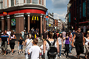 Crowds of tourists Outside MacDonalds on Shaftesbury Avenue in the West End,