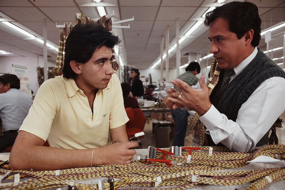 Supervisor lecturing a computer assembly worker at an  IBM computer factory in Guadalajara, Mexico.
