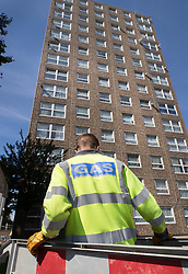 © Licensed to London News Pictures. 11/08/2017. London, UK. Gas company employees work to cut off the gas to the tower blocks on the Ledbury Estate in south London. Residents on the estate have been told they will have to leave their properties over the next few weeks. A structural survey carried out after the Grenfell fire found cracks that could lead to a collapse if a gas explosion occured in one of the flats. Photo credit: Peter Macdiarmid/LNP