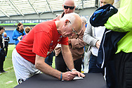 Tommy Charlton of England over 60's signs autographs after the match during the world's first Walking Football International match between England and Italy at the American Express Community Stadium, Brighton and Hove, England on 13 May 2018. Picture by Graham Hunt.