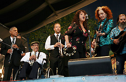 05 May 2012. New Orleans, Louisiana,  USA. <br /> New Orleans Jazz and Heritage Festival. <br /> R/L; Bonnie Raitt, 9 time Grammy award winner with Maria Maldaur (Midnight at the Oasis), Mark Braud, centarian trumpet player 'Uncle' Lionel Ferbos and clarinetist Charlie Gabriel of the 'Preservation Hall and Friends' ensemble. <br /> Photo; Charlie Varley