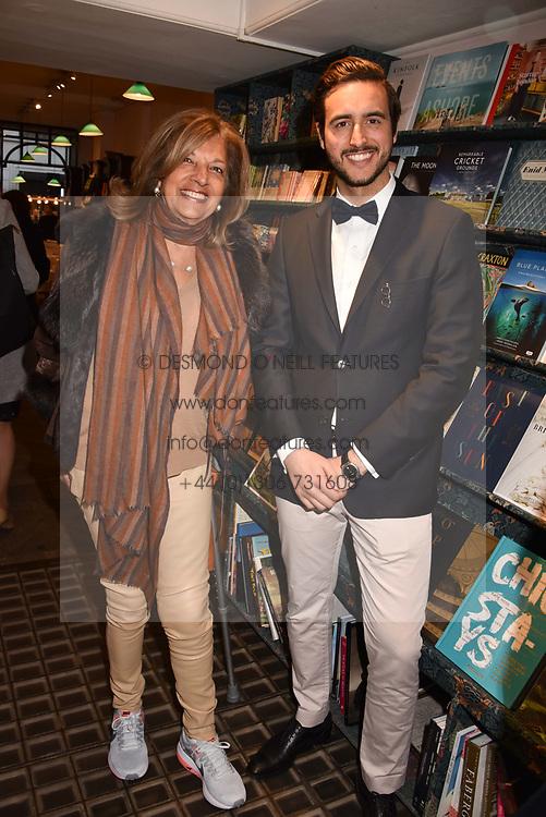 Dr Filip Koidis and Vimla Lalvani at a party to celebrate the publication of Saving The World by Paola Diana at Daunt Books, Marylebone, London England. 2 May 2018.