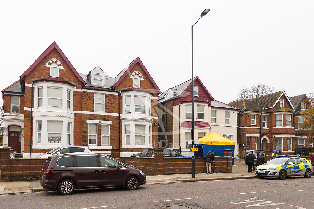 A police tent has been erected outside the Victorian House converted to 12 flats at 65 Craven Park Road, Harlesden, West London, where two Improvised Explosive Devices were discovered by workers refurbishing a flat. Harlesden, London, November 22 2018.
