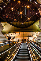 The escalator leading from the plaza outside Denver International Airport to the airport train station, Denver, Colorado USA.