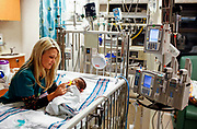 Resident Nurse Laurie Kierna, feeds 33 day-old Tyler Wright in the Pediatric Intensive Care Unit at Rush University Medical Center on Friday December 24, 2010. <br /> <br /> (William DeShazer/ Chicago Tribune) B58936644Z.1<br /> ....OUTSIDE TRIBUNE CO.- NO MAGS,  NO SALES, NO INTERNET, NO TV, NEW YORK TIMES OUT, CHICAGO OUT, NO DIGITAL MANIPULATION...