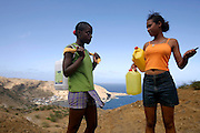 Girls chat on the way to a water spring on Brava's east coast. Nearby, Furna is the place where is located the only harbour that serves the island when sea conditions allows ships to navigate.