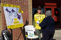 Donna Cilley talks with Pat Cloutier outside of Belmont High School prior to going in to vote on Tuesday morning.  (Karen Bobotas/for the Laconia Daily Sun)