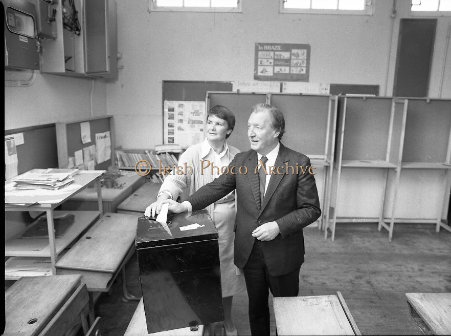 Charles Haughey Votes in Referendum..1983.07.09.1983.09.07.1983.7th September 1983..Image of Mr Haughey,.leader of Fianna Fail,and his wife Maureen cast their votes in the National School,Kinsealy,Dublin. ..The referendum was a constitutional amendment with regard to the life of the unborn... It was a divisive campaign with much debate, charge and countercharge by both sides of the argument..Those in the Yes campaign won the day with a vote of 841,233 to a no vote of 416,136..