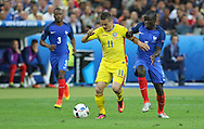Romania Midfielder Gabriel Torje and \France Midfielder Ngolo Kante during the Group A Euro 2016 match between France and Romania at the Stade de France, Saint-Denis, Paris, France on 10 June 2016. Photo by Phil Duncan.