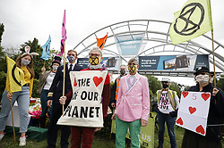 © Licensed to London News Pictures. 29/08/2020. Gatwick, UK. Members of the Extinction Rebellion protest group hold a Mad Hatters Tea Party themed demonstration at Gatwick Airport south of London. Large scale protests are expected in central London as Parliament opens on Tusday 1st September. Photo credit: Peter Macdiarmid/LNP