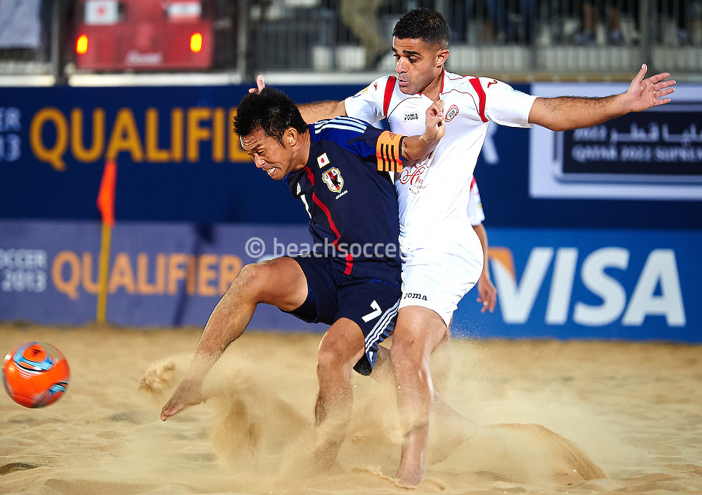 DOHA, QATAR - JANUARY 23:  Takeshi Kawaharazuka of Japan competes for the ball with Mohamad Mechleb of Lebanon during the FIFA Beach Soccer World Cup 2013 Qualifier Qatar at Katara Beach on January 23, 2013 in Doha, Qatar. (Photo by Manuel Queimadelos)