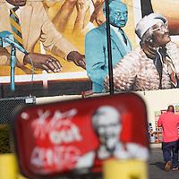 A man walks towards a mural located beside a Kentucky Fried Chicken in Philadelphia, PA December 1, 2016.