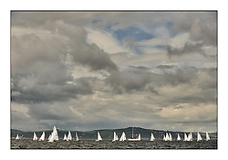 470 Class European Championships Largs - Day 2.Wet and Windy Racing in grey conditions on the Clyde...The gap in the sky...